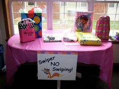 Jayla's Dora themed birthday party! The gift table w/ the Swiper sign (wish I had waited to take the picture when all the gifts were there!)