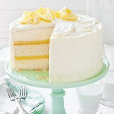 A creamy frosting and tangy curd filling create the gorgeous layers of this lemon cake. The post A creamy frosting and tangy curd filling create the gorgeous layers of this lemo appeared first on Win Dessert. Layer Cake Recipes, Frosting Recipes, Dessert Recipes, Lemon Layer Cakes, Dessert Blog, Lemon Desserts, Cupcake Recipes, Mini Cakes, Cupcake Cakes
