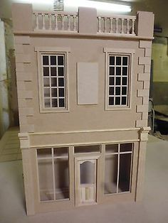 Most made in both scales and The Largest Dolls House Maker in the UK over 60 different designs. All our houses are made from MDF (external and internal walls) backs and are designed and built by us in Carmarthenshire, Wales by Dolls House Direct. Cardboard Dollhouse, Dollhouse Kits, Wooden Dollhouse, Large Dolls House, Dolls House Shop, Doll Houses, Georgian Doors, Deco, Japanese Style House