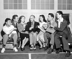 On the set of Her First Beau, Theodore Reed gets some pointers from a number of youthful players he has directed in various films: William Tracy, Jackie Cooper, Bonita Granville, Jane Withers, Ken Howell and Buddy Pepper   (1941)
