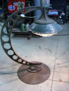 lamp project made from a very large dial caliper..antique copper heat lamp and the base is an old farm plow disc.
