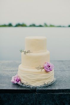 similar to the one i posted before, maybe with a cute beach themed cake topper from david's bridal on it