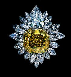 Tiffany & Co. brooch with a 107-carat canary diamond surmounted by a 23-carat pear-shaped D-flawless white diamond and surrounded by 80 carats of marquise and pear-shaped white diamonds