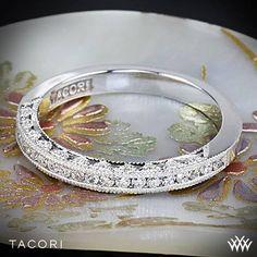 This stunning diamond half eternity ring is pictured with round channel-set diamonds. Tacori Classic Crescent Illuminate Diamond Wedding Ring