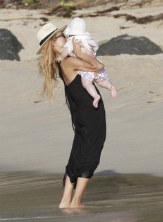 Designer and stylist Rachel Zoe enjoys a day at the beach with her husband Roger Berman and son Skyler in St Barts, Caribbean on January 4, 2012.
