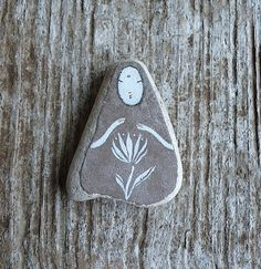 This is made from a large piece of beach pottery. I have used acrylic paint and charcoal, and a matte lacquer.  Measures approximately 3,2 x 4 cm.
