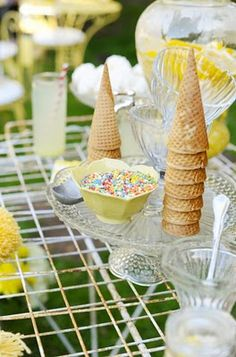 Ice cream bar with different kinds of sauces, cones, sprinkles