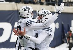 Tanner Mangum threw four touchdown passes and BYU beat Utah State 51-28 on Saturday.