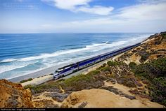 On a beautiful sunny morning along the Pacific Coast, Amtrak F59PHI No. 458 leads an Amtrak surfliner south towards San Diego from Oceanside...