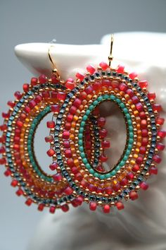 Hand woven bead by bead with a tasteful mix of color, these hoops enhance beauty and temptation. Gypsie inspired with size and color. Ear wires