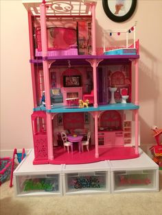 Barbie Storage and Organization: wire tie boxes together; get a 2x3 nonskid rug pad to keep house from sliding!