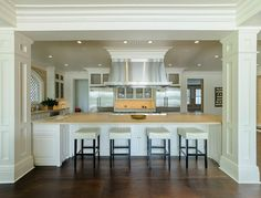 hUGE center island. Stately.. dramatic kitchen with plenty of room for other people to hang out and join in !!!why not