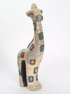 Gazing Giraffe. $62.00. Raku is a collector's quality ceramic art form involving hand molding, hand painting and firing earthenware.  Our pieces pass through the hands of at least eight skilled crafters, making them truly one of a kind.  Given their uniqueness, color may vary slightly on each piece.  Mbare, Ltd. certifies that each piece of Raku Art is handcrafted in Africa and the designs are the originals of our artists. Made in S Africa.