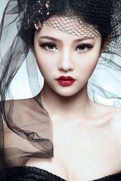 Wow! She has the skin of snow, ruby red lips, jet black hair. Same features told in the fairytale story Snow White.