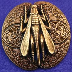 large Art Nouveau brass button, insect motif