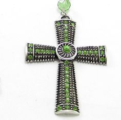Peridot Crystal Cross Pendant Necklace on a Angel by GlobalBrights