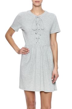 "Soft jersey pull over dress featuring a lace up front. Relaxed fit.  Approx. Measures: 34"" long from shoulder to bottom hem.  Jersey Lace Up Dress by Babel Fair. Clothing - Dresses - Short Sleeve Clothing - Dresses - Casual Nolita Manhattan New York City"