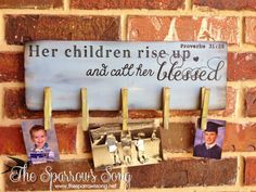 """""""Her children rise up and call her blessed. - Proverbs 31:28"""" ~ wood sign + clothespin photo hanger. $25+shipping. {www.thesparrowssong.net}"""