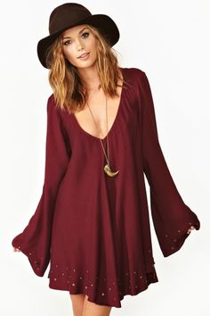 Flowy wine dress featuring a deep v neckline, bell sleeves  brass studded detailing. find more women fashion ideas on www.misspool.com
