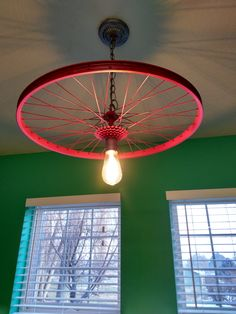 Bike rim light #repurposed this #bike rim to make #update an old light fixure.  #diy