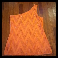 Orange off the shoulder tank top Orange off the shoulder tank top. Super sexy, has tiny little sequins and a built in bra!! Never worn. Express Tops Tank Tops