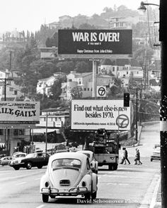 "As part of their new campaign against the war in Vietnam, John Lennon and Yoko Ono place stark black-and-white billboards in eleven international cities proclaiming ""WAR IS OVER!"" and then, in smaller type, ""If You Want It. Happy Christmas From John And Yoko,"" 16 Dec 1969. Photo is of the billboard that appeared on the Sunset Strip."