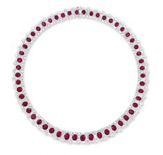 AN IMPORTANT RUBY AND DIAMOND NECKLACE   The highly articulated necklace designed as a series of oval and cushion-shaped rubies, each within a brilliant, baguette and tapered baguette-cut diamond surround, mounted in platinum, 42.3 cm long