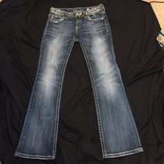 Authentic Miss Me bling jeans Miss Me distressed size 28 JP4288-SR...inseam on tag says 31 but I measure them at 29 1/2! Do not look altered, so I do not understand why they measure shorter!! Bought on eBay (paid good money too) and I love them, but a tad short for me. Hate to let them go, but with any heel...would be too short for me. Just wanted to be honest about length, because the tag does say 31! Miss Me Pants