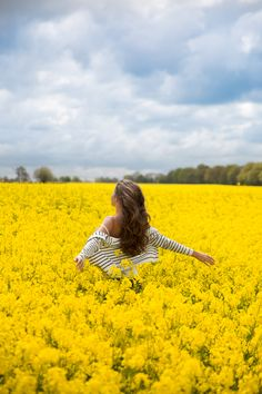Striped cardigan in British rapeseed fields. Having such a yellow moment![The Londoner.]