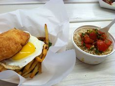 Frita Batidos - a Cuban-inspired eatery in downtown Ann Arbor that serves Cuban-style street food. This is a beef frita (burger topped with shoestring fries and a sunny side up egg) and coconut ginger rice.