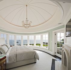 Stunning coastal bedroom - fireplace, tv, dome ceiling, lots of lighting.