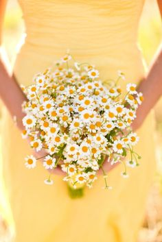 Keep things sunny and simple with daisy bouquets.