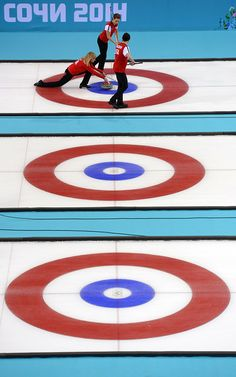 rika Brown of the U.S. releases the stone during Curling Women's Round Robin match between USA and Canada on day nine of the Sochi 2014 Winter Olympics at Ice Cube Curling Center on February 16, 2014 in Sochi, . (Photo by Lars Baron/Getty Images)