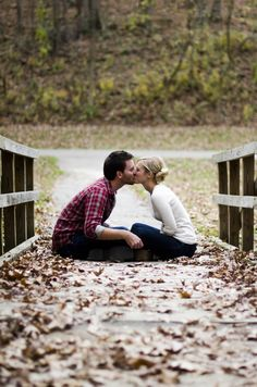 Fall engagement picture. Their noses look awkward but I like the bridge and the leaves