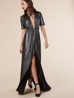 You're basically about to be out and drinking til NYE and you need some fancy shit that accommodate this new holiday social calendar. This is an ankle length dress with a very low neckline and elastic at the waist.
