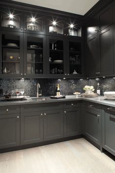 Kelly Deck Design: Gorgeous black kitchen design with oak wood floors, black shaker kitchen cabinets, gray ...