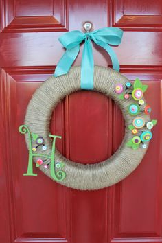 Cute as a button wreath. Great for guests looking for the right house...maybe I can make it instead of paying $50