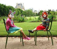 My kiddos wearing these creepy or fun(?) masks in Paris.