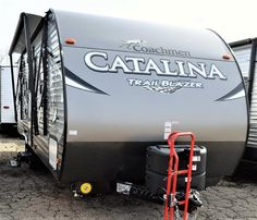 """THIS RV MAKES OUTDOOR RECREATION EASY!   2017 Coachmen Catalina Trail Blazer 22TH  Bring along your ATVs, kayaks, bikes, and more with this 29', 5,556 lb. (dry) toy hauler that puts fun first! Easily load your favorite toys and gear thru the rear ramp and head out for fun! Rest easy after a day on the trails with the plush queen bed and nice fold-down sofas. Includes a 32"""" TV and stereo!  Give our Catalina Trail Blazer expert Karin Florida a call 810-834-9851 for pricing and more information. Coachmen Rv, Toy Hauler, Forest River, Atvs, Kayaks, Outdoor Recreation, Motorhome, Sofas, Trail"""
