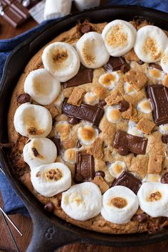 You won't be able to resist this ooey gooey s'mores skillet cookie cake! It's loaded with crisp graham crackers, melty chocolate and toasty marshmallows!