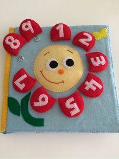 ぷちっと嵌めて固定するスナップボタンは小さなお子さんにも扱いやすく、布絵本にもよく使われます。こちらは花びらの部分に数字を入れ、読み方を学べるようにしてある可愛い知育おもちゃです。