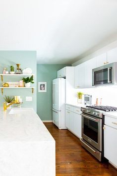 From the kitchen to the bedroom and every room in between, accent walls can change the entire vibe of your living space. Here are 16 accent wall ideas that will get your wheels turning. #hunkerhome #accentwall #accentwallideas #accentwallinspo #accentwalllivingroom Kitchen Paint, Kitchen Design, Kitchen Cabinets, Cabinets To Go, Kitchen Redo, White Cabinets, Mint Green Kitchen, Mint Kitchen Walls, Small Kitchen Layouts