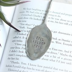 This antique silver spoon was hand stamped, flattened and bent into the perfect little bookmark for all of those bookworms out there!