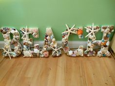 Use letters to spell trip location & cover with trinkets for memories. Use rocks from moonstone beach and spell cambria