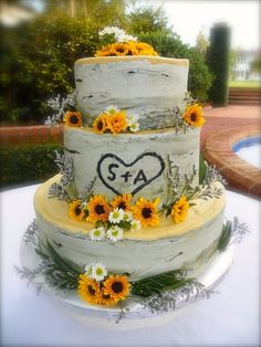 Birch cake decorated with wildflowers (black eyed susans, daisies).