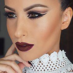 "#motd #latergram Eye details on last post Mixed Makeup Forever Mat Velvet and Kat Von D's foundation. @lagirlcosmetics to conceal and contour. Makeup Forever matte bronzer. Mac ""Peaches"" blush. Bobbi Brown ""Bronze Glow"" highlighter. Mac ""Currant"" lip pencil and Kat Von D ""Vampira"" liquid lipstick  #glamrezy"