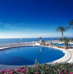 Luxurious outdoor swimming pools in the private gardens of the hotel.