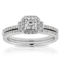 Ikuma Canadian diamond two-piece wedding set with a 1/3 carat, SI clarity, Ikuma Ideal Square cut center diamond. Other non-Ikuma diamonds equal an additional 1/4 carat total weight. This bridal set is crafted of 14K white gold. <b>All Ikuma diamonds originate from North America and are mined in Canada.</b> American Gem Society (AGS) documentation provided on center Ikuma diamond.