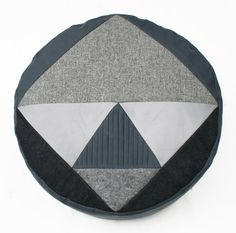 Vader Grey patchwork pouffe. by FunMakesGood on Etsy Handmade geometric patchwork pouffe. Designed and made in our studio in Glasgow, from locally sourced wools, leather and pleated cotton in shades of grey.  Vader Grey contains a removable bean bag liner that can be topped up in future with polystyrene beans.  50cm x 50cm x 30 cm as it is a handmade product, dimensions may vary slightly.