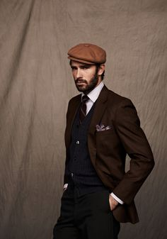 Tweed cap, beard, and pocket square. Handsome indeed.